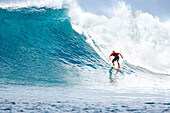 INDONESIA, Mentawai Islands, Kandui Resort, young man surfing on a large wave at Bankvaults
