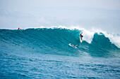 INDONESIA, Mentawai Islands, Kandui Resort, young man surfing on wave, Bankvaults