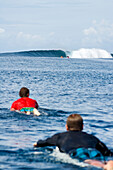 INDONESIA, Mentawai Islands, men paddling on surfboards towards the surf break, Bankvaults