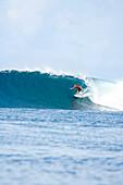 INDONESIA, Mentawai Islands, Kandui Resort, surfer on a wave at Bankvaults