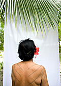 INDONESIA, Mentawai Islands, Kandui Resort, portrait of a Mentawai elder with tattos named Tatiana