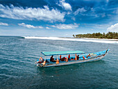 INDONESIA, Mentawai Islands, surf boat anchored at a wave called Bankvaults