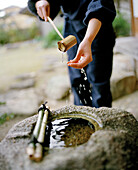 JAPAN, Kyushu, woman washing her hands at the Yoyokaku Ryokan