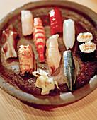 JAPAN, Kyushu, close-up of fresh sushi served on Karatsu Pottery, Tukunda Restaurant