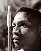 MADAGASCAR, mid adult man holding spear, close-up, Beza Mahafaly (B&W)