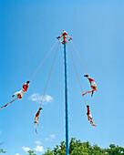 MEXICO, Maya Riviera,Totonac Indians pole flying, Tulum Ruins