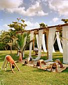 MEXICO, Maya Riviera, kids doing yoga, Esencia Hotel and Villas
