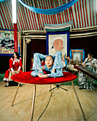 MONGOLIA, Ulaanbaatar, a young acrobat performs at the Abtai-Sain Khan Palace