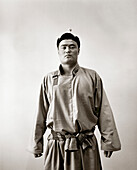 MONGOLIA, Ulaanbaatar, portrait of a Mongolian wrestlers in traditional dress at the Olympic school facility (B&W)