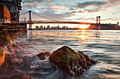 USA, Brooklyn, View of the Williamsburg Bridge and the East River at Sunset from Brooklyn