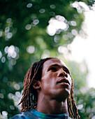 PANAMA, Bocas del Toro, portrait of a young man in the jungle, Central America