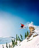 USA, Utah, skier in midair jump, Baldy Shoulder, Alta Ski Resort