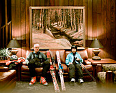 USA, Utah, senior man and woman sitting in ski gear at Alta's Rustler Lodge