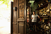 VIETNAM, Hanoi, the owner of an old fan shop in his shop in the old quarter