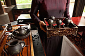 VIETNAM, Hue, Ms. Boi Tran performing a tea ceremony and ritual at her home