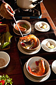VIETNAM, Hue, Ms. Boi Tran serves a dish she calls Shrimp with five tastes at her home in Hue