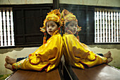VIETNAM, Hue, Tu Duc Tomb, a young dancer is dressed in traditional Vietnamese costume and waits to perform with his mother