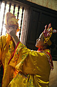 VIETNAM, Hue, Tu Duc Tomb, dancer Ms. Nguyen Ngoc Thien and her son dress in traditional Vietnamese costume and prepare for a performance