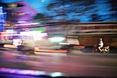 VIETNAM, Saigon, Ho Chi Minh City, mopeds speed through the city at night