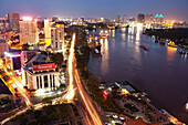 VIETNAM, Saigon, Ho Chi Minh City, an elevated view of the city and the Saigon river at night shot from the top of the Renaissance Riverside Hotel