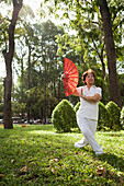 VIETNAM, Saigon, Ho Chi Minh City, women exercise and perform perfect movements with fans in the early morning
