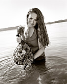 USA, Washington State, portrait of woman holding a bag of oysters, Puget Sound, Totten Inlet, Olympic Peninsula (B&W)