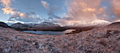 Vast panorama of the snow-covered North West Highlands overlooking the summits of Sgurr Dubh, Liathach and Beinn Eighe (from left) over the Loch Clair in Winter at sunrise, Torridon, Scotland, United Kingdom