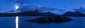 Panorama overlooking Loch Bad a 'Ghaill to the summits of Stac Pollaidh, Cul Beag, Sgorr Tuath and Ben Mor Coigach during a full moon night, Assynt, Scotland, United Kingdom