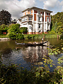 Gondola on the River Alster in front of a historic villa in the city centre of Hamburg, Hanseatic City of Hamburg, Germany