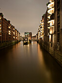 Illuminated buildings in the historic Speicherstadt, Hanseatic City of Hamburg, Germany