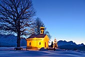 Snow-covered chapel with Christmas tree and Wetterstein range in background, Kruen, Werdenfels, Bavarian Alps, Upper Bavaria, Bavaria, Germany