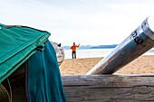 Fly fisherman at the beach of Lake Tahoe, California, USA
