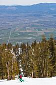 Man downhill skiing, Heavenly ski resort at Lake Tahoe, High Sierra Range, Nevada, USA