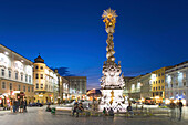 Main square in the evening with the baroque Holy Trinity column, also known as Plague column, Linz, Upper Austria, Austria