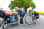 Mother and son travelling by bicycle, Kroechlendorff, Uckermark, Brandenburg, Germany