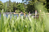 Children bathing in lake Kuchenteich, Boitzenburg castle, Boitzenburg, Uckermark, Brandenburg, Germany