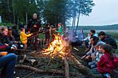 Campfire at campground at lake Ellbogensee, Mecklenburg Lake District, Mecklenburg-Western Pomerania, Germany