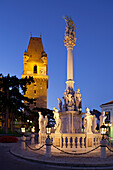 Fortified tower and column in the evening light, Plague column, Perchtoldsdorf, Lower Austria, Austria
