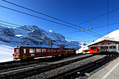 Jungfraubahn trains in the station at the ski resort of Kleine Scheidegg , Swiss Alps, Jungfrau - Aletsch, Bernese Oberland, Switzerland, Europe