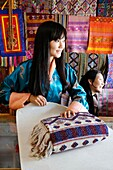 Bhutan (kingdom of), District of Paro, the City of Paro, in Chencho Handycraft shop, Mrs Chuki Wangmo and her very nice daughter Tandin Bidha, a movie actress // Bhoutan (Royaume du), district de Paro, la ville de Paro, dans le magasin de produits artisan