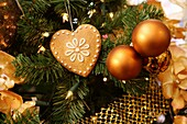 Christmas decoration  Golden baubles and gingerbread on tree