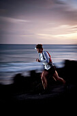Blurred view of runner on rocky trail. Hoapili Trail