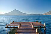 Wooden pier in still lake