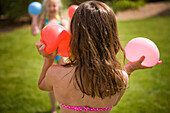 Girls playing with water balloons