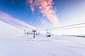 Chairlift over snowy landscape