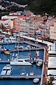 France, Corsica, Corse-du-Sud Department, Corsica South Coast Region, Bonifacio, elevated view of the port, dusk
