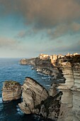 France, Corsica, Corse-du-Sud Department, Corsica South Coast Region, Bonifacio, Circuit des Falaises, cliff walk, elevated view of city and cliffs
