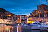 France, Corsica, Corse-du-Sud Department, Corsica South Coast Region, Bonifacio, port and Citadel, dusk