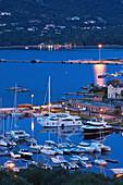 France, Corsica, Corse-du-Sud Department, Corsica South Coast Region, Porto Vecchio, elevated view of the marina, dusk