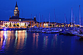 France, Nord-Pas de Calais Region, Nord Department, French Flanders Area, Dunkerque, Bassin du Commerce marina and town hall tower, dusk